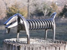 This plier dog has long ears and a long curvy tail! Hes just as cute as all the others, too! The sculpture has been welded from found objects