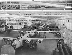 """Looking up one of the assembly lines at Ford's big Willow Run plant, where B-24E (Liberator) bombers are being made in great numbers."" (photo between July 1942 and February 1943; Library of Congress)"