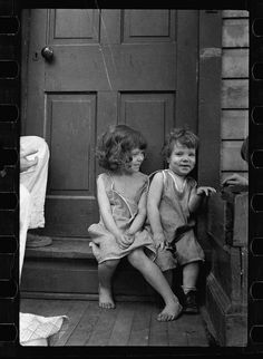 carl mydans | Carl Mydans. Small girls sitting in doorway of house ... | BlackandWh ...