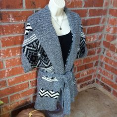 Aztec graphic sweater jacket Beautiful black, grey, and white print cardigan with waist tie. Pair with a long sleeve black top for a perfect fall outfit. Old Navy Sweaters