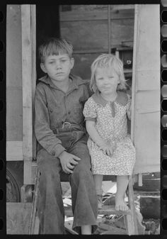 Children of migrants sitting in doorway of trailer, Edinburg, Texas. 1939 Feb. Library of Congress.