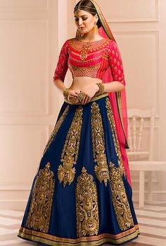 Mustard Raw-silk Blouse With All Over Embroidery With Rani Paris Silk In Skirt With Butta Embroidery Gives Amazing Look Which Is Completed By Orange Net In Pallu.