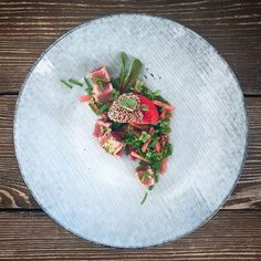 Grilled tuna steak salad with watermelon, sesame seeds, snow peas and chilli.