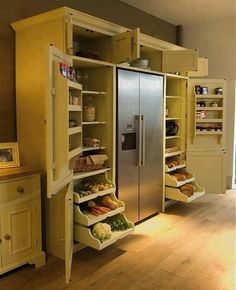 Refrigerator surrounded by built in pantry.......what a great idea!