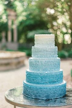 Love a ruffled wedding cake, especially one that is ombre.