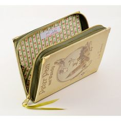 Peter Pan Book Clutch by PS Besitos The loveliest one-of-kind handmade purse! The cover is made of printed on cotton fabric and binded, as a normal book would be. It's finished with golden metal corners to embellish and protect the clutch.
