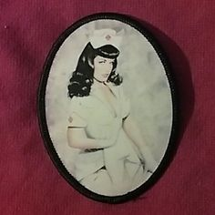Bettie Page iron on patch An oval-shaped patch with Betty Page in the center wearing a nurse's uniform C&D visionary Inc Other
