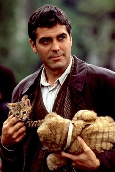George Clooney 28 Ridiculously Hot Celebrities With Incredibly Cute Cats George Clooney, Cute Kittens, Cats And Kittens, Crazy Cat Lady, Crazy Cats, I Love Cats, Cool Cats, Celebrities With Cats, Men With Cats