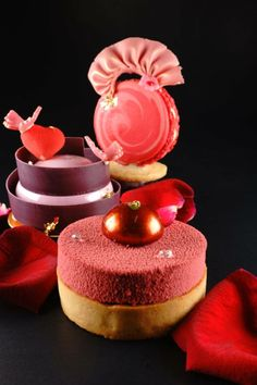 Venice tart Made from raspberry milk chocolate ganache and raspberry mousse, topped with raspberry bonbon 2 Macaron cupidon Made from mascarpone vanilla cream and strawberry rhubarb jelly 3 Love Made from rose petal cream and raspberry lychee jelly DHARA DHEVI CAKE SHOP,Chiang Mai, Thailand