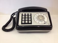 Depending upon the technology available in your area, you may have had a telephone similar to this one which was able to function via dial or push button.