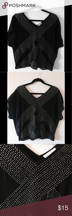 ✨Joie black beaded 💯% silk top✨ Joie black top with dark silver bead detailing - Top is semi sheer (I would just wear a black bralette under) - 100% silk - Top itself is in excellent condition, but there is some beads missing (see pic) - Size: Medium. Definitely wanted to hang on to this one, but it's much too big for me now. Joie Tops