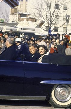 In a photograph that, five decades later, feels at once haunted and familiar, a smiling President and First Lady ride through cheering crowds in the inaugural parade, their very clothes evoking a similar sunny scene enacted less than three years...