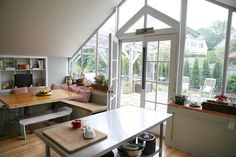 The MacMillans' Converted Greenhouse- Conversion projects are pure fun. I like the dining area. It feels more relaxed and the large window allows for more natural light. Greenhouse Kitchen, Home Greenhouse, Kitchen Spotlights, Barn Kitchen, Kitchen Ideas, Kitchen Decor, Tiny Spaces, Inspired Homes, Dining Area