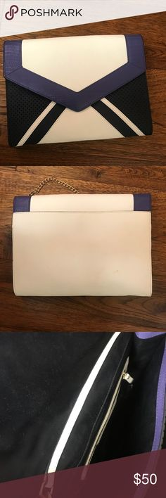 """Juicy Couture Envelope bag/clutch. Beautiful and stylish clutch/shoulder bag.  Perforated navy leather, white leather and royal blue combine to make a great geometric bag with front snap closure.  Oversized envelope clutch with detachable gold shoulder chain.  Snap pocket on the entire back (white photo) and one zipper pocket inside.  Satin lining, never used.  11"""" wide, 9"""" tall & 1.5 inches thick. Juicy Couture Bags"""