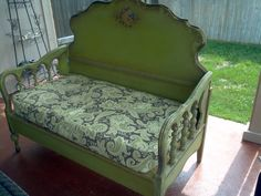 We created a sofa bench for our outdoor living room from an old headboard & footboard...love it! My concept...my brother built it.