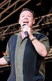 "UB40's former frontman Ali Campbell performing in 2008. This reggae/pop music band main contributions to the British reggae scene was popular through the 1980's and 1990's. They had many hits; most notable hits were ""Red Red Wine,"" ""Kingston Town,"" and ""(I can't Help) Falling in Love with You."""