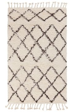 The geometric pattern and tasseled fringe of this classic shag rug will completely tie in the rest of the living room decor. Such a great find at NSale!