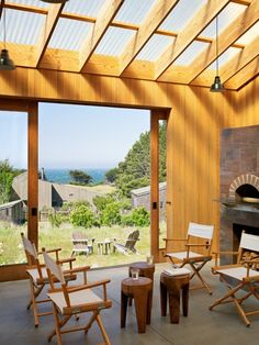 Awesome Clear Corrugated Roof Panels for Exterior Design Ideas : Terrific Clear Corrugated Roof Panels With Firewood Storage Sliding Door Wooden Chairs Light Bulb Lamps Wooden Tiny Coffee Table Patio Chair Design Exterior, Roof Design, Design Design, Pergola With Roof, Pergola Plans, Corrugated Roofing, Corrugated Plastic, Sea Ranch, Enclosed Porches