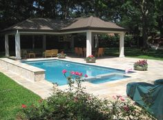 Custom designed and built gazebo with standing seam metal roof, stucco columns, and pool remodel in the Memorial area of Houston, Texas.
