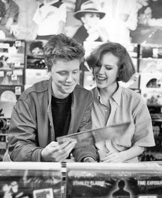 Anthony Michael Hall & Molly Ringwald browsing in record shop during break in location shooting of The Breakfast Club, May How adorable! Anthony Michael Hall, 80s Movies, Good Movies, Movie Tv, Iconic Movies, Cult Movies, I Love Cinema, Pretty In Pink, Molly Ringwald