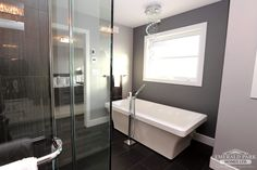Spa-like master ensuite with free-standing soaker tub and custom tile shower