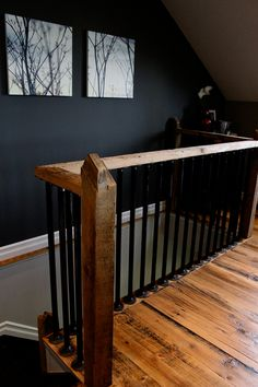 Steel pipe spindles, hemlock floor boards. Solid beam hand rail.