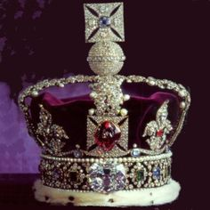 The Imperial State Crown was originally made for Queen Victoria in 1838. Many of the gems in this beautiful crown are of very ancient origin, whilst others count their age by centuries or even by decades...bearing in the front the second largest portion of the Star of Africa (the Cullinan 2 diamond or Lesser Star of Africa - 317.40 carats); it was given to Edward VII, who had it set in the crown.
