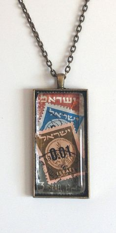 "Vintage Israeli Stamp Necklace set behind glass in Bronze Colored 1"" x 2"" setting with matching 24"" inch chain. Each piece is hand made and unique. History lovers and Hipsters, these necklaces are very hip with a nice twist of history. This stamp features 1960 Provisionals stamp muted colors. Ancient Hebrew coin from the period of the War of the Second Temple #jewish jewelry, #jewish necklace #jewish gift #chanukah gift #israel gift #israel stamps"