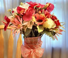 Attach silk flowers to pens with florist tape...cute teacher gift for Valentine's Day.