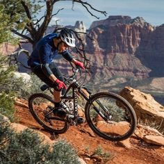 A mountain biker with #fullsuspensionmountainbike on a traill