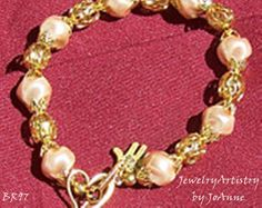 Dimple Pearl Bracelet Pink with Gold by by JewelryArtistry