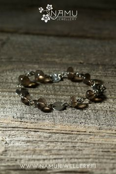 Silo One bracelet. Made of handcrafted, recycled silver and ethically sourced smokey quartz from Uhlu, Finland. The stones in Silo are tumbled to remind pebbles at a beach. Bangles, Beaded Bracelets, Smokey Quartz, Jewellery, Diy Jewelry, Jewelry Collection, Gemstones, Finland, Silver