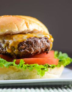 Asian BBQ Burgers with Sriracha Mayo are Asian-inspired burgers made with hoisin sauce, sesame oil, and spices to create a slightly sweet and spicy burger.