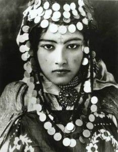 Tunisian Berber woman, with tattoo and traditional jewellery (early 1900s)
