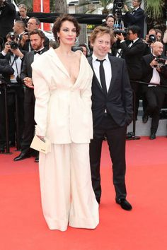 French actress Jeanne Balibar and French director Mathieu Amalric pose as they arrive on May 18 2017 for the screening of the film 'Barbara' at the...