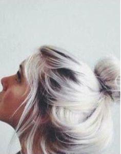 White platinum blonde with dark plum roots..