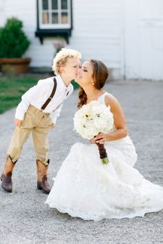country rustic wedding ring bearer in cowboy boots