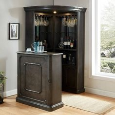 Maximize your dining or living room area while utilizing vertical and corner space! This Voltaire tall curio set by Furniture of America features glass shelves, metal racks, wood cabinet space and so much more. The standing bar table provides an additiona Wood Bar Table, Bar Table Sets, Bar Tables, Corner Curio, Corner Bar, Home Bar Sets, Home Bar Designs, Wine Glass Rack, Wood Bars