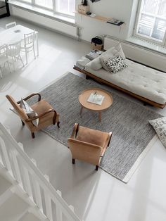 This monochrome interior complemented with a few mid-century pieces and soft textiles is true perfection.
