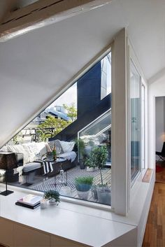 Like the way the glass juts into living space (but might not apply because stairs)