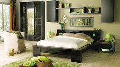 Zen Decorating Ideas for a Soft Bedroom Ambience. I love this!!! My furniture is dark brown, light green walls, black trim but I want to paint it white. I need to have less stuff in my room in order to make it tranquil but that will never happen unless I add more rooms to the house.