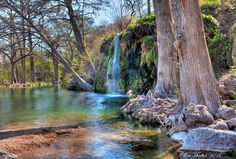 Krause Springs is a well-known camping & swimming site located in the beautiful Hill Country of Texas. It is located in Spicewood, Texas approximately 30 miles west of Austin. There are 32 springs on the property, and several feed the manmade pool and the natural pool which flows into Lake Travis. There is primitive tent camping as well as 24 RV sites with water and electricity available.