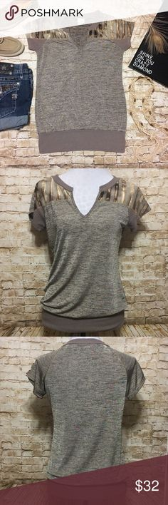 Buckle Daytrip Subtle Metallic Top Super cute Knit top by Daytrip. Neutral toned lightweight Stretchy top with subtle hints of gold metallic throughout. Split v-neck, shirt sleeves, banded bottom. Decorative shoulders with burnout stripe detailing. Purchased at Buckle. Tag is faded but it's a size large. Also fits a medium flatteringly. No flaws other than that faded size tag. Buckle Tops Blouses