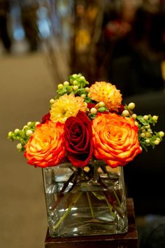 Orange, red and yellow fall floral arrangement by Beautiful Blooms by Jen.