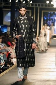 sherwani falls well below the knees, and looks elegant especially