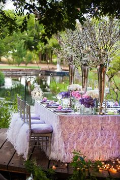 pink white an purple tablescape, feathers, ruffles table decor