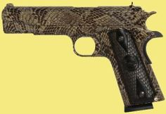 """Erfahren Sie mehr: http://www.all4shooters.com/de/News/Kurzwaffen/Iver-Johnson-Snake-Series-1911/  US-Hersteller Iver Johnson hat ein Faible für außergewöhnliche Finishes. Die neuesten Kreationen heißen """"Copperhead"""" und """"Water moccasin"""". Sie erinnern dabei stark an das Äußere der beiden nordamerikanischen Schlangenarten."""