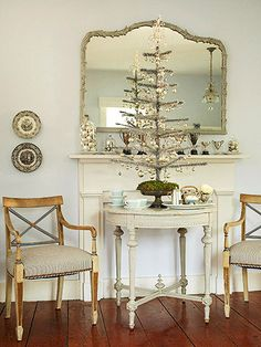 An Elegant Affair  --  Add sophistication to your Christmas decor with silver. Silver ball ornaments are easy to find and inexpensive to decorate en masse. The baubles really twinkle when hung from a silver tinsel tree.