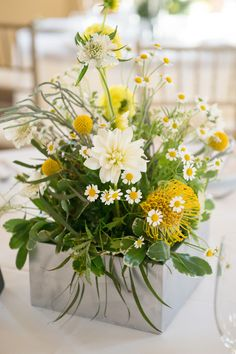 Green and yellow wedding centerpiece.  Texture and free-form flowers were the emphasis of this amazing arrangement created by Flowers by Kim.