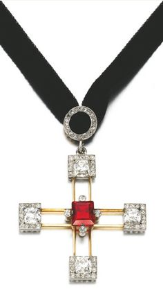 SPINEL AND DIAMOND CROSS PENDANT, LATE 19TH CENTURY Designed as a cross set at the centre with a step-cut spinel, accented with cushion and single-cut diamonds, Russian marks.